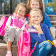 Girls with backpacks in the outside — Stock Photo