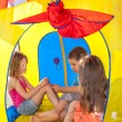 Three kids playing inside the camping tent — Stock Photo