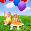 Stock Photo: Toddlers playing with balloons