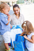 Kids looking into shopping bags — Stock Photo