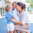 Businesswoman with small children — Stock Photo