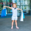 Peschool girl in front of the shopping center — Stock Photo