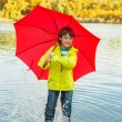 Boy in rubber boots — Stockfoto
