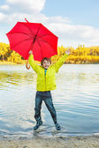 Boy in rubber boots — Stock Photo