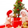 Babies looking for presents — Stock Photo #30738863