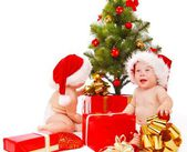 Babies looking for presents — Stock Photo