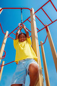 Hanging on gymnastic rings — Stock Photo