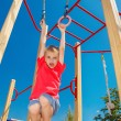 Boy on the gymnastic rings — Stock Photo #30810027