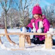 Stock Photo: Preschool girl making snowballs