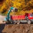 Truck and excavator — Stock Photo
