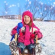 Girl with a snowball maker — Stock Photo