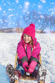 Girl on sledges — Stockfoto