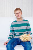 Teenager with popcorn — Stock Photo
