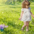 Preschool girl in a garden — Stock Photo