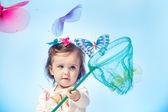 Toddler catching butterflies — Stock Photo