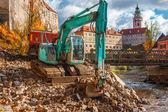 Excavator putting stones to the truck — Zdjęcie stockowe