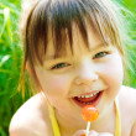 Girl with lollipop — Stock Photo #8643979