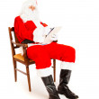 Santa Claus with wish list — Stock Photo #8652115