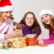 Friends packing presents — Stock Photo #8686038