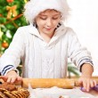Kid rolling dough — Stock Photo #8686570