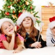 Kids in Santa hats — Stock Photo #8686643