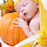 Baby sleeping on a pumpkin — Stock Photo #8691929
