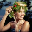 Vegetables-style portrait of a blond lady - Stock Photo