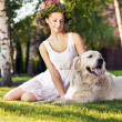 Smiling woman with dog — Stock Photo #13875538