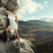 Stock Photo: Young lady posing in mountain