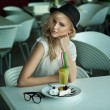 Young beauty in a restaurant — Stock Photo