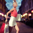 Стоковое фото: Smiling girl with shopping bags