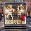 Two shopping women on exhibition window — Stockfoto