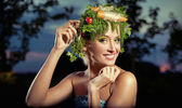 Vegetables-style portrait of a blond lady — Stock Photo