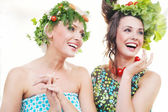 Adorable young women with vegetables hairstyles — Stock Photo