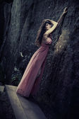 Stunning beauty in a fashionable dress — Stock Photo