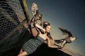 Elegance lady holding eagles — Stock Photo