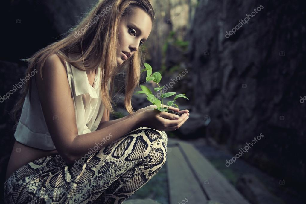 One plant in female hands — Stock Photo #13876013