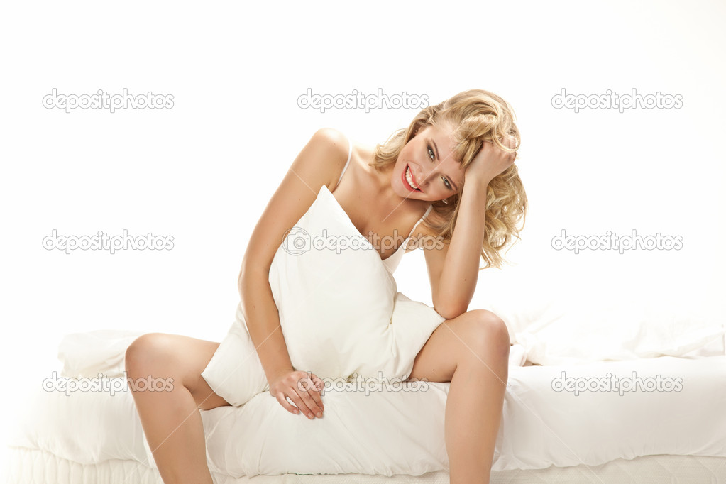 Portrait of beautiful woman, she sitting on white bed — Stock Photo #13877623
