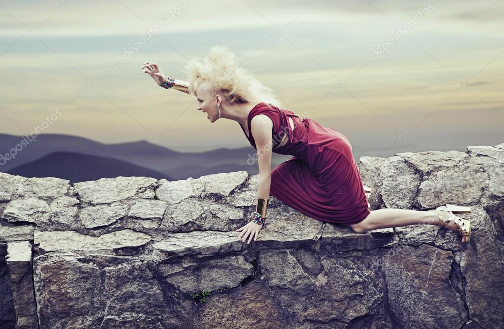 Angry young lady in a nature scenery  Stock Photo #13878798