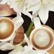 Stock Photo: Cups of coffee with flowers