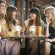 Foto de Stock  : Four girls enjoying meeting