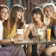 A group of women in the coffee shop - Stock Photo