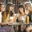 Group of women in coffee shop — Stock Photo #13884368