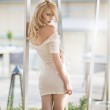 Sexy blonde woman in white dress — Stock Photo