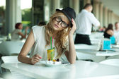 Cute woman in a cafe — Stock Photo