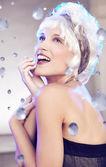 Smiling woman among diamonds — Stock Photo