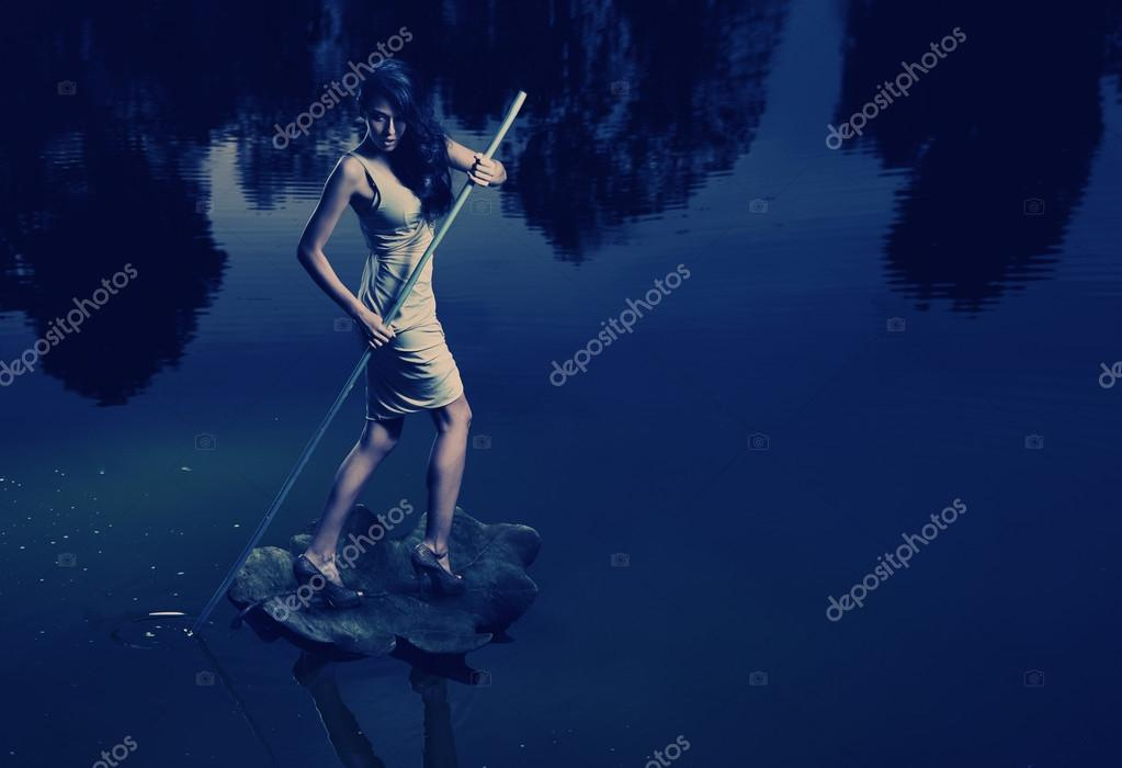 Fine art image of a woman sailing a leaf  Stock Photo #13884311