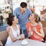 Young friends having coffee break — Stock Photo