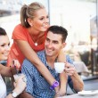 Stock Photo: Couple with a friend during lunch