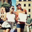 Two smiling girls holding empty board — Stock Photo #14324999